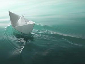paper boat sailing 154996543