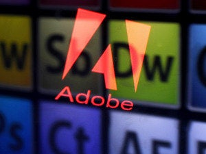 Adobe logo and products reflected in displays.