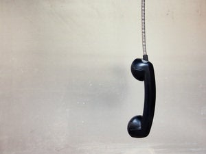 Dangling retro phone receiver