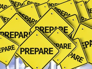 multiple road signs with the word prepare on them