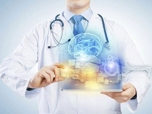 Doctor in holding tablet with medical images floating out of it