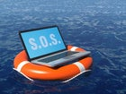Laptop floating on life preserver in ocean needing to be rescued