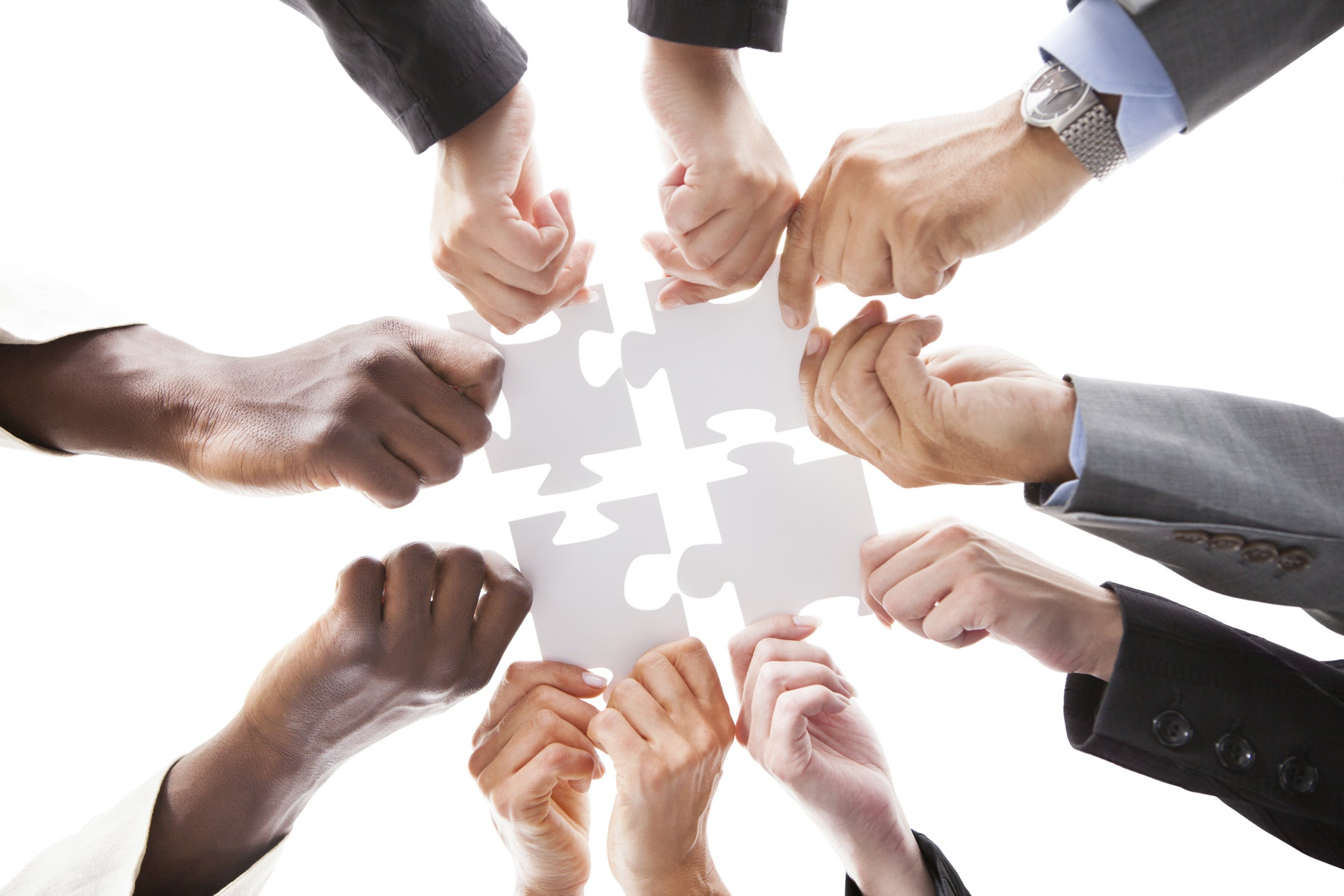 teamwork puzzle organized pieces together