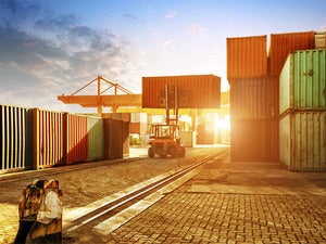 Colorful cargo containers at sunrise