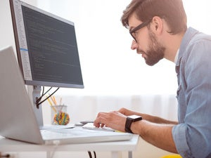 Hipster millennial working on computer