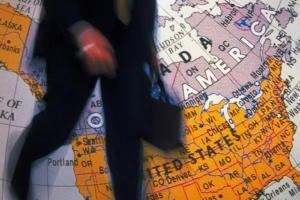 H-1B visa man entering U.S. with briefcase